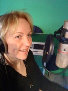 Maria singing in the studio